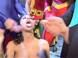 Wonder girl deepthroats all the superheroes' meatpipes