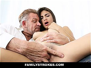 young Latina sandwiched by stepfather and stepbro