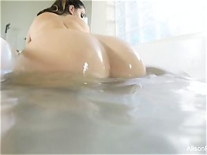 huge-chested Alison Tyler takes a tub