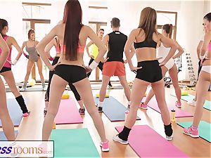FitnessRooms astounding backsides on flash before girl-on-girl stunners