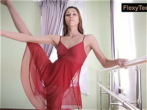 insatiable gymnast Inessa in a crimson sundress