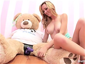 Brett Rossi plays with a slammed bear's strap-on fuck stick