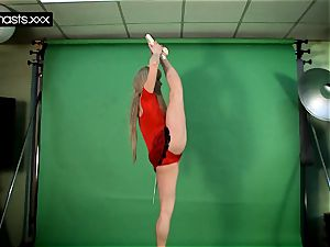 red clad Gymnast Doing opens up
