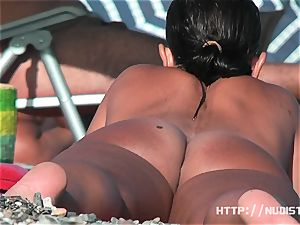 Playful dolls showcase their titties in the nude beach